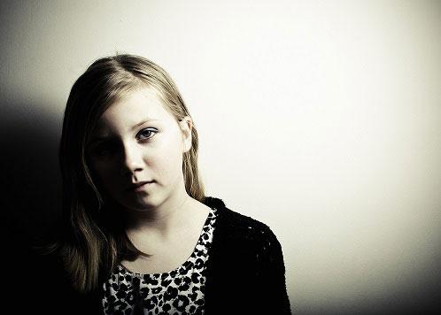 sad child looking at camera